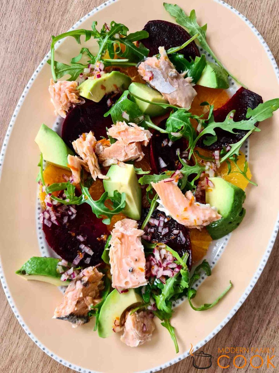Avocado, beet and orange salad with salmon