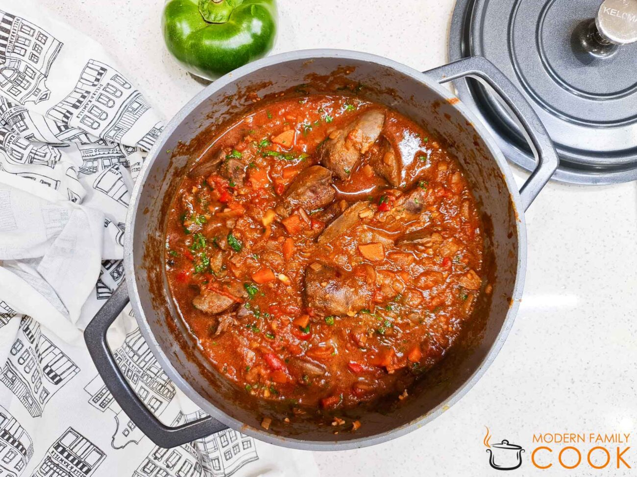 Liver with tomatoes and vegetables